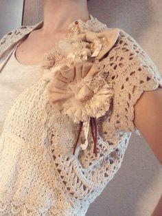 Handmade brooch on a little sweater.  So cute.