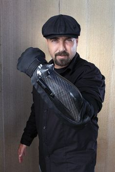 The Bodyguard The device is a heavy armored glove equipped with a powerful taser, laser pointer, flashlight and camera – all equipped to deter and stop criminals and zombies. Armas Airsoft, Apocalypse Survival, Zombie Apocalypse, Zombie Weapons, By Any Means Necessary, Survival Tools, Zombie Survival Gear, Survival Fishing, Survival Equipment