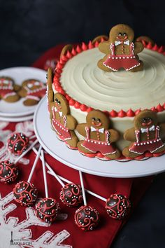 Spiced gingerbread cake is iced with tangy cream cheese frosting and decorated with gingerbread man cookies!