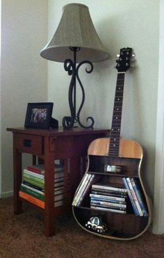 Looks like I'm going  garage sale shopping and find a cheap guitar and make this...Like soon.