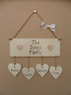 Personalised Family Name Plaque. Main plaque is personalised with your familys surname. Hanging hearts are personalised with your names. Choose from the drop down menu the number of names required. If more than 10 names are required contact me and I shall add this to the listing.