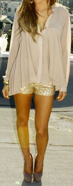Gold shorts. Sheer shirt.