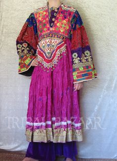 #Afghan #dress - from tribalbazaar - Whew! Bright. (It takes a rich personal coloring to wear a richly colored dress like this. I think. On the other hand, wear what makes you happy!