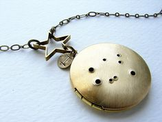 I'm not super into zodiac signs, but this Gemini constellation locket is neat.
