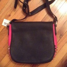 A cross body bag BNWT 👍👍👍 Absolutely perfect....1-color...black/pink/gold tone studs(this matches everything.. And is good for any season)2-compartments...plenty..plus the space in the compartments r deep and roomy...3-cross body....safe stylish and hands free 4- zipper closure plus snap and on back another zip closure 👍👍👍 Bags Crossbody Bags