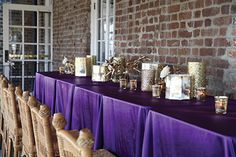 Guests could watch boats sail from the Ashley River while dining at tables draped in purple and gold, and lit with gold pillar candles and votives in gold mercury glass.