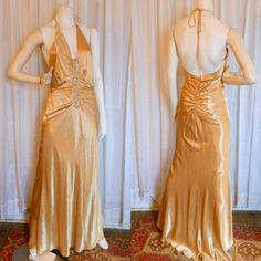 Vintage Evening Gown.1930s style,  gold satin. formal  dress halter. fishtail. prom.  bodycon. old hollywood. glamour. bombshell. size 8. $59.00, via Etsy.