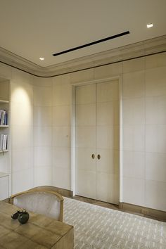 A Parchment Paneled Room by Atelier Viollet