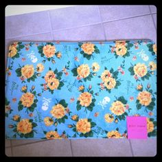 """NWT Betsey Johnson Memory Foam Floral Bath Rug NWT Betsey Johnson Bath Mat/Rug. A vibrant yellow and orange rose floral print with white skulls scattered throughout. It is a plush and absorbent memory foam. It has a skid resistant backing. The rug measures 21"""" x 34"""". It is machine washable and tumble dry. I have two of these and can bundle if you need a set. Betsey Johnson Other"""