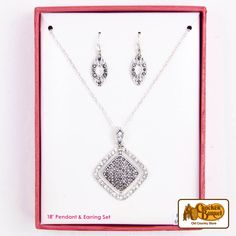 This sparkling necklace and earring set makes a beautiful and memorable gift for any occasion. The dangling oval-shaped earrings sparkle in the light, and the delicate silver square design of the matching pendant is both simple and eye-catching.      Answer fun questions and you could win in the Cracker Barrel Old Country Store Pick it to Win it Sweepstakes. Start 'picking' your answers at crackerbarrel.com/win (ends Jan 2, 2013).