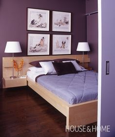Simple bedding and table lamps let purple-grey walls and wood floors take the spotlight in this design. In this small condo bedroom, a maple platform bed smartly incorporates two built-in side tables. Photographer: Donna Griffith Products: Bed, velvet pillow, Ikea; Wall colour, Café Gray (2039), Pratt & Lambert.