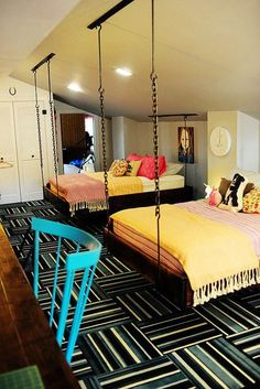 A great way to work with sloped ceilings for a guest room suited to my nieces/nephews.