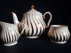 Art Deco tea pot with sugar and milk jug from English company Sadler and marked gold . This wonderful set is in excellent condition and comes
