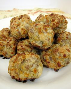 "Cream cheese saugage balls 1 lb hot sausage; 8 oz cream cheese; 1.25 cups Bisquick; 4 oz cheddar cheese Form1"" balls,bake 20-25min @ 400*"