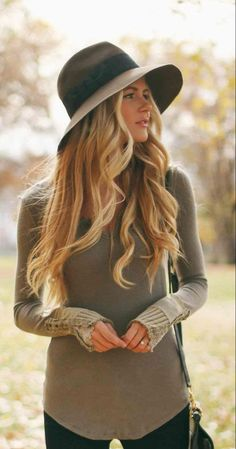 Long flowing curls and a hat. So pretty!