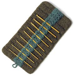 Kluster...felted crochet hook case features a lacy, un-felted crocheted panel in a contrasting color, an ingenious device to organize your crochet hook collection in style