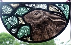 Hanging Stained glass panel designed and created by Sarah Roberts Stained Glass Art.