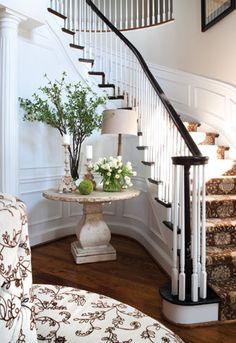 Pretty table but... I love the idea of a banquette in a large entry way!