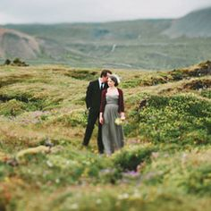 A gorgeous Iceland wedding on the rocks by the sea - and a gorgeous gray wedding dress!