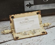 Repurposed antique hinge used as a business card holder.