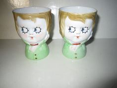 Just divine! Well, in this context they are! Except... each has her left hand up in an impossible position. Two Antique Noritake Nippon Hand Painted Googly Eye Egg Cups
