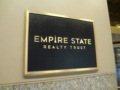 Cast metal brass plaque with border and beveled edge, raised copy in satin brass in NYC. We specialize in custom plaque signage in New York, NY. Visit our website below to contact us for a free consultation! www.PlaquesNewYork.com