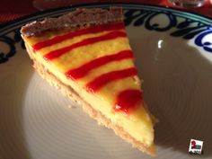 Custard tart topped with a red spiral made with rhubarb. OMG It was finished in a couple of minutes.