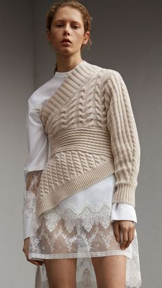 A cashmere sweater created from a collage of cable and rib knits with a flattering cinched waist. Revealing elements of garments worn underneath, the cropped, asymmetric shape is cut to reflect Henry Moore& sculptural forms. Knitwear Fashion, Knit Fashion, High Fashion, Fashion Outfits, Womens Fashion, Fashion Trends, Fashion Details, Fashion Design, Fashion Photo