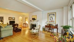 This #UES #1bed #coop features a decorative fireplace and a dining room.