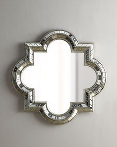 """Quatrefoil Mirror Handcrafted of glass, resin, and wood composite. Beveled mirror. 34""""W x 2""""D x 34""""T. Imported. Weight, 18 lbs. Boxed weight, approximately 35 lbs."""
