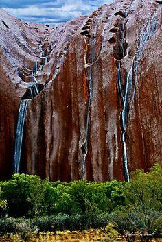 Rain flowing off Uluru - rare event in the Northern Territory, Australia
