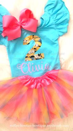 In Stock & Ready to Ship Size 2 - 4 Yrs This sweet flutter sleeve leotard is the perfect for your tiny minion lovers birthday. Girly & full of ruffles, she can still hang with her pals and love banana