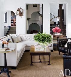 Tufted sectional w/ nailheads - good furniture arrangement too, TV could go on wall behind the chairs
