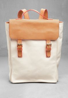 "love all the ""& other stories"" stuff: leather and canvas rucksack."