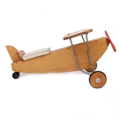 Moulin Roty Classic Wooden Ride-On Plane at alexandalexa.com