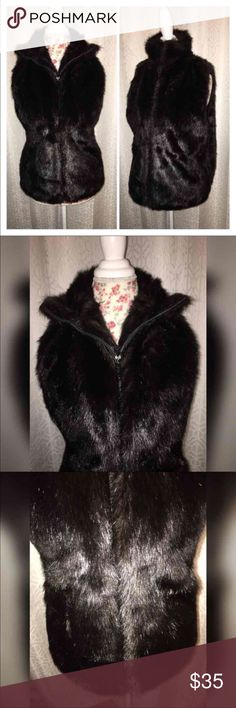NWOT JOOLAY FAUX FUR VEST SZ LG GORGEOUS This gorgeous faux for vest has a zipper front closure which is very convenient it is in excellent condition and a very dark brown color it is a size large and 26 inches from the shoulders this is a must have!!!THIS IS PERFECT WITH A LONG SLEEVES AND JEANS!!! BOHO LOOK!! Joolay Jackets & Coats Vests