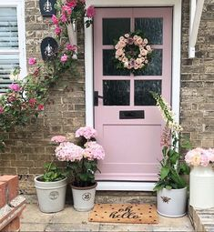 Decorate your front door with lots of seasonal flowers and pots to make it feel like summer. The pastel pink front door is the dream! We're not just your average doormat. Our doormat is produced from the best quality & well coloured doormat base and we use quality paints produced in the UK especially for our door mat material to be used indoor and have good water resistance for outdoor use. #pastelpink #pinkfrontdoor #frontdoor #frontdoordecor #flowers #doormat #ohhello #spotty #pink…