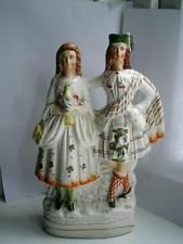 Victorian Staffordshire pottery figure group Scottish Lad Lass & bird C1890