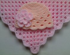Crocheted blanket, hat and baby booties set for your little one. Material: Baby Care high quality acrylic yarn, very soft, satin ribbon, pearls. Machine warm wash at 40C Made with love.  Blanket sizes: 23 x 23 ( 60cm x 60cm ) 27 x 27 ( 70cm x 70cm ) PLEASE SELECT A SIZE.  Baby Hat and Booties Sizes:  Hat 0 - 3 months, booties 3.5 ( 9cm ) Hat 3 - 6 months, booties 4 ( 10cm ) Hat 6 - 9 months, booties 4.5 ( 11cm )  Please select a size.  For more blankets in my shop please look here…