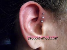 Triple Forward Helix Piercing by Piercing by Tommy Towne, via Flickr