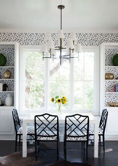 dramatic dining room with dalmatian polka dot wallpaper in black and white | via…