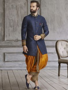 Shop Navy golden silk dhoti style indo western online from India. Mens Indian Wear, Indian Groom Wear, Indian Men Fashion, Indian Man, India Fashion Men, Groom Fashion, Men's Fashion, Mens Sherwani, Sherwani Groom