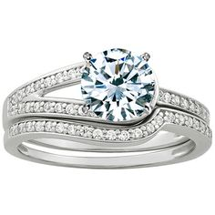 Another conflict-free diamond engagement and wedding ring set. I like the idea of two bands combining into one on the other side of the solitaire.