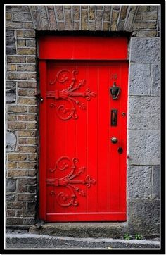 I have a thing for bright coloured front doors...Red Door
