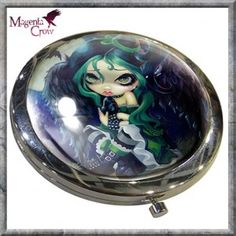 Perched and Sat and Nothing More Compact Mirror Jasmine Becket Griffith. A stunning and colourful compact mirror featuring the artwork of Gothic Fantasy artist Jasmine Becket Griffith. Quality print set on a chrome compact that opens to reveal the mirrors inside. A beautifully printed Gothic Fantasy compact mirror featuring the fantasy art of Jasmine Becket-Griffith and features a beautiful Gothic, Fantasy EMO Fairy with black wings. Ideal to pop into one of our Gothic, Alternative handbags…