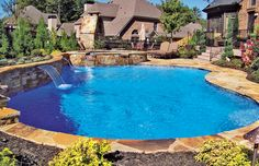 Nice general design.  Flagstone coping.  Elevated wall on one side of pool.  Landscaping.