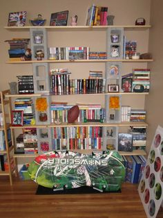 This is my 'college bookshelves' - I went to lowes home store and bought some boards and bricks - no more particle board bookcases collapsing!  Still plan on disassembling and spray painting bricks and boards.  My boards are 1 inch thick by 12 inches deep and either 6 or 8 feet long