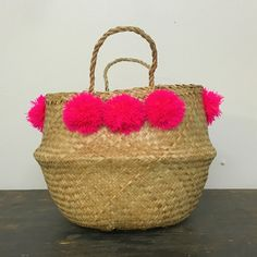 """handmade, colorful pom pom basket small size: approximately 12"""" tall not including handleplease allow two weeks all sales final"""