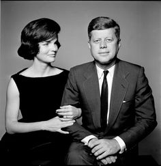 John & Jackie Kennedy in an official portrait.  She wears a favorite LBD with no bling other than her wedding ring.  Great bandeau neckline shows off her great bone structure. Sleeveless was chic and the bell shaped skirting was trendy.
