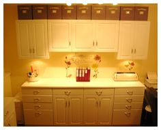 Awesome craft room, and what a great idea for storage above cabinets in the kitchen (very unobtrusive)